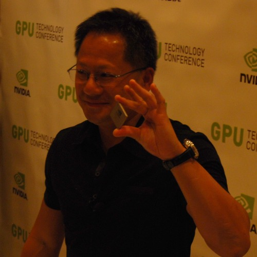 "Here's Jen-Hsun holding the GT300 chip. So what does he think of Intel's Larabee and them showing off ray-tracing demos and games? In his own words, ""First, they should buck up on DirectX performance"". Well, it's true in a sense that Intel has yet to master that properly, let-alone change the industry from rasterization to ray-tracing for games. Oh well, we'll see how it pans out next year."