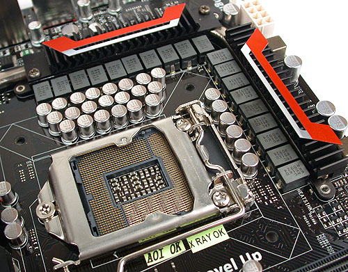 Lots of chokes and capacitors surrounding the CPU socket. ASUS claims a 16-phase power scheme for the CPU, with 3 additional for CPU VTT. Hence the total of 19 chokes. The heatsinks are quite understated, linked by a heat pipe and should not pose any interference with the CPU cooler.
