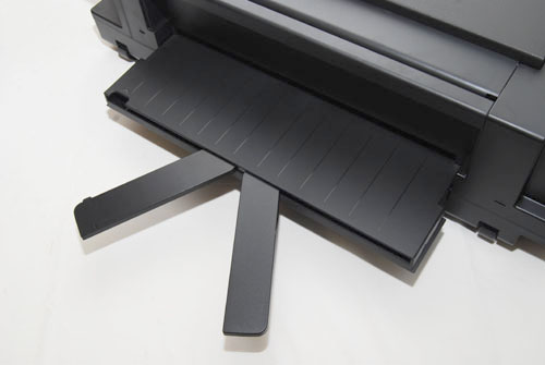 A pair of holders spring out to help hold the A3-sized paper in place. You'll have to factor in the extra space at the back whenever you want to print A3.