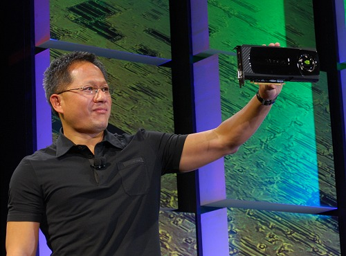 NVIDIA CEO and Co-Founder, Jen-Hsun Huang proudly showing off the new GT300 based graphics card whose architecture is codenamed Fermi and will be the base for all new GeForce, Quadro and Tesla class products coming in the near future.