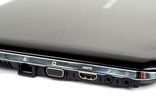 The left flank is dedicated to multimedia purposes mostly. A combination of LAN, VGA, HDMI and audio ports are aligned neatly next to its air vent. Markings on the silver accent be hard to discern due to its reflective nature.