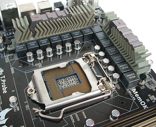 The ceramic-based heatsinks surround the LGA1156 socket on the ASUS SABERTOOTH. The chokes and capacitors here are all certified to meet military standards.