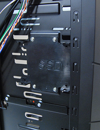 You can attach an optional SSD tray to the side of the 5.25-inch drive bays for a single SSD.