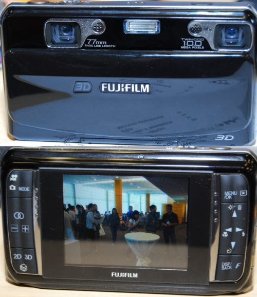 Top picture: The Fujifilm FinePix REAL 3D W1 has two lenses and two CCDs. The captured image data by the twin lens-CCD system goes through the RP (Real Photo) Processor 3D which then merges the left and right images in a single 3D image. Bottom Picture: The camera features a selection button that allows you to view the same picture in 2D or 3D. You can't really see it here, but the screen is currently showing a picture in 3D.