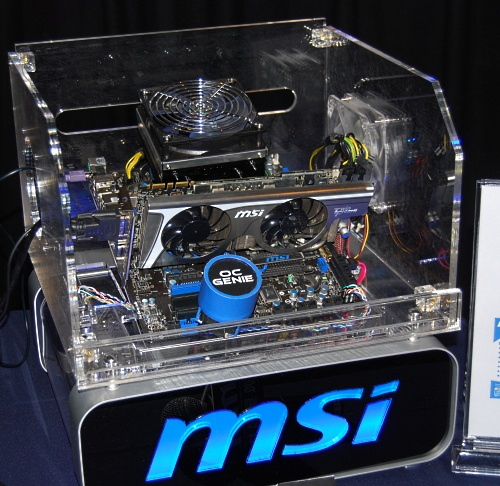 MSI's demo system for the presentation, a MSI P55-GD65 fitted with a Core i7-870 and a impressively huge CPU cooler. Don't worry, the giant OC Genie button here is for illustration, the actual button is of course much smaller.