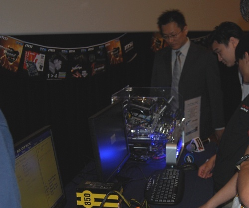 There was a bit of time after the presentation for some hands-on. Here was MSI's Project Manager Garrett Wu looking on as local enthusiasts try out the OC Genie feature.