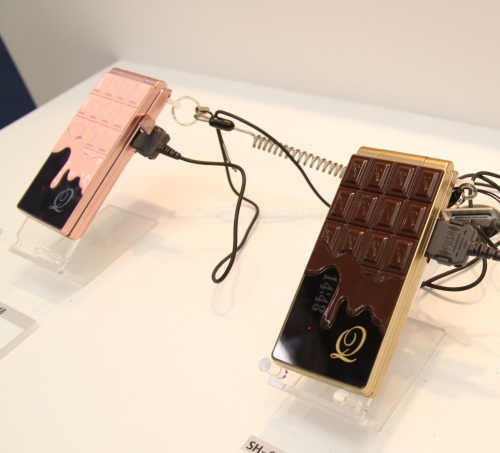 DoCoMo's QPot series of designer chocolate bar design phones come in pink and chocolate. They're W-CDMA-based with 570 hours of standby and 220 minutes of talktime. With video, it gives about 110 minutes.
