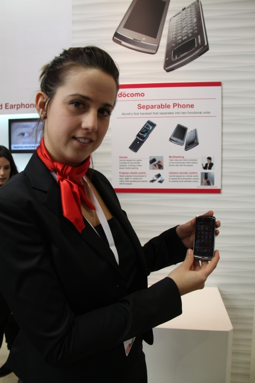DoCoMo also showed the world's first handset that splits into two functional units. The first part is the screen unit itself, which can also attach to an optional pico-projector module, while the second part is the keypad unit. Each unit comes with its own battery unit. Attached, the phone measures 114 x 51 x 20.4mm and weighs 173g.