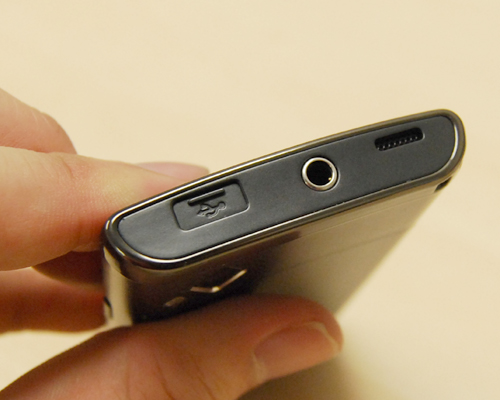 The microUSB port is protected by a sliding cover. At its side is the 3.5mm audio port, supporting 5.1 surround sound.