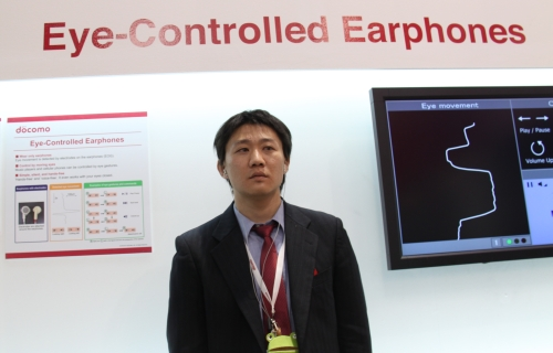 The theory with the eye-controlled earphones is that the eyeballs have electric potential (positive energy at the cornea, negative at the retina). By moving the eyes in specific directions, the user is able to signal to the electrodes on the earphones to play/pause, skip track or change volume of the music player/phon