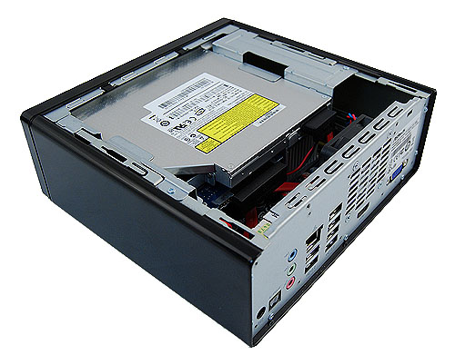 Removing the casing cover, this is what we see. A drive cage holds the slim optical drive and 2.5-inch HDD. Below it lies the mini-ITX form factor AMCP7A-ION motherboard.