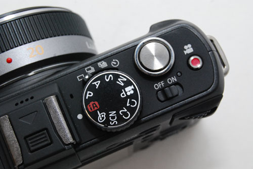A handy video button next to the shutter release lets you record video immediately while in photo modes.