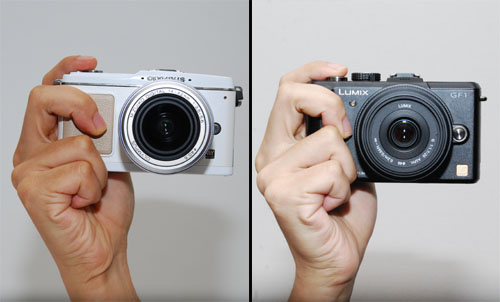 The E-P1's heft tends to lean towards the left (away from the shutter button) while the GF1's heft feels more evenly balanced.