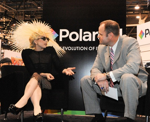 And the reason for the crowd - Lady Gaga was at the booth to be unveiled as Polaroid's new creative director, essentially a brand ambassador and spokesperson for the company.