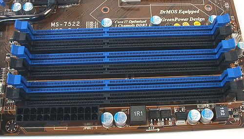 Six full rows of DIMM slots, color coordinated for triple channel memory kits. A possible grouse for those using memory modules with larger, protruding heat spreaders or coolers is the proximity of the ATX power connector to one of the DIMM slots. Other than that, we were surprised not to find MSI compromising the quantity of DIMM slots.