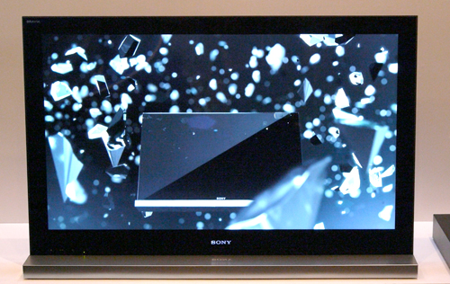 "After all that jibber jabber, we reckon it's hard to imagine Sony's new Monolithic design if we don't have a picture to show. This is not a swanky photo-frame by the way, but a ""frameless"" BRAVIA NX700 resting on a very monolithic silver base."