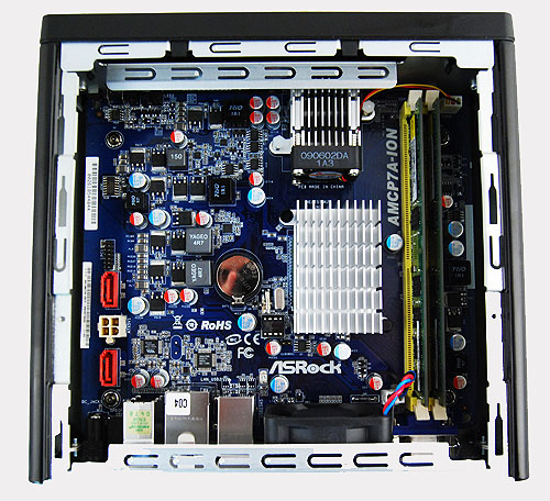 Removing the drive cage, we finally see the AMCP7A-ION mini-ITX motherboard in its full glory.