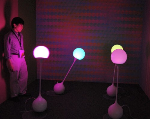 Here's a display of dynamic color composition using full-color LED device and the colors change with regards to the interaction the surrounding light source and that of the colors on the wall. While the end result is purely artwork that tickles the senses with the dynamic color changes, it's based on research and supported by the Japan Science and Technology Agency.