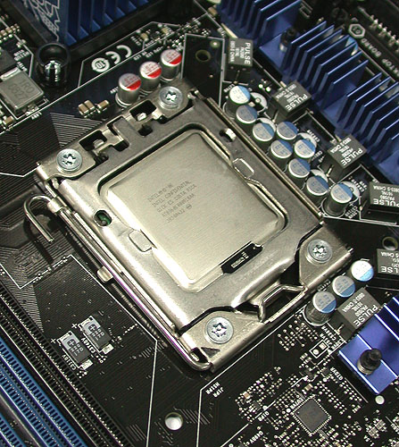 The actual Extreme Edition Core i7-965 chip that we received from Intel, already installed in its new socket on the reference X58 board.