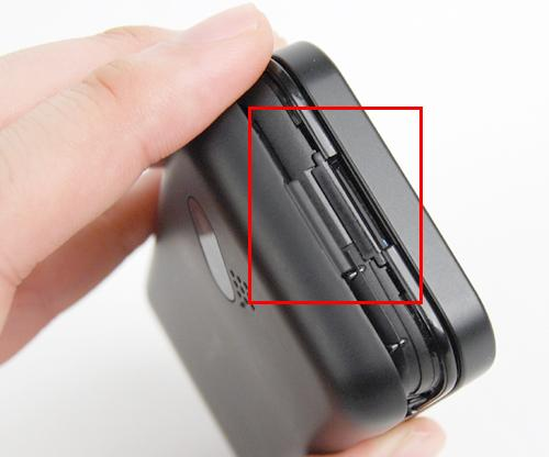 Though there's a small catch (highlighted in red) to latch your nails onto and pry the casing open, it still made us pretty squeamish in opening it.