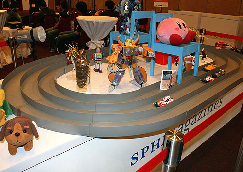 The focus of this PlayTest is on photography and videography and naturally, the highlight of the event is this diorama that's set up in the middle of the venue. Consisting of a variety of objects, from toys to a Tamiya track complete with fast moving model cars, there are different scenarios to test the budding photographer.