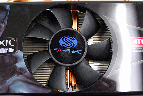 A closer look at the cooler's 80mm fans. Underneath it, you can see the heatsink and its many fins and grooves, and the three copper heat pipes. These heat pipes help cool the card by quickly transferring heat away from the GPU core.