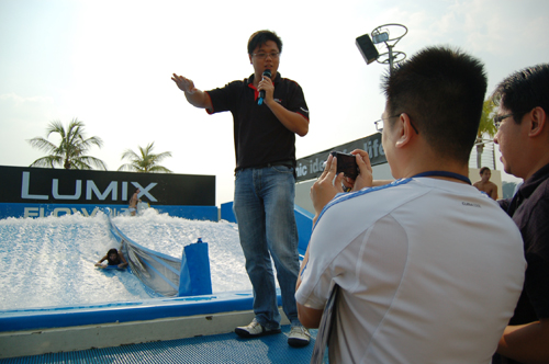 Wilson Ang, Marketing Executive, leading the media in a casual photography session that literally set their skills against the speed of the waves. Objective: To capture the best action shot of models surfing at the wave pool with the Panasonic DMC-FP3. The lucky winner gets to walk away with a brand-new camera of the same model.