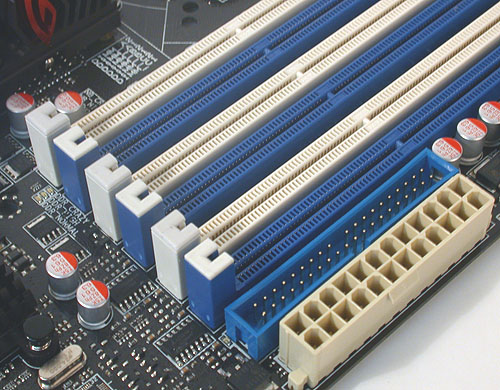 The DIMM slots on the Gene only have the usual latches on one end. The other end, shown here has no latches, making it easier to remove in a space constrained environment like a microATX board. Notice too how close the IDE and power connectors are placed.