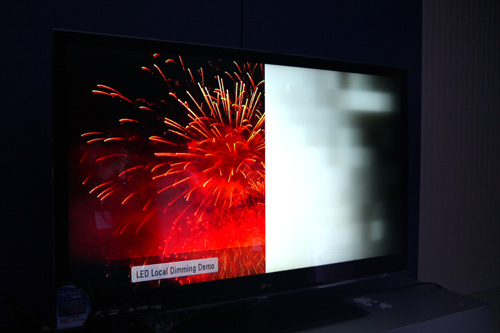 A live moving image is displayed on the left half of the screen, while LG's localized dimming is shown working in tandem on the right.