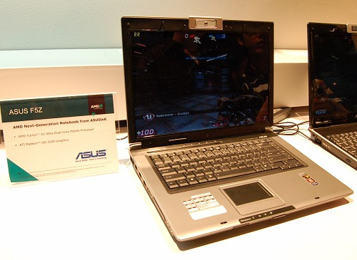 Next up, we have two similar ASUS notebooks to showcase the difference that Hybrid graphics can make. In this photo, we've here an ASUS F5Z notebook that's using the basic Puma platform, thus running off the Radeon HD 3200 graphics and running the UT3 benchmark. It averages around the 30FPS mark, but often gets to the twenties range in more taxing segments as seen on screen.