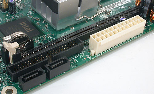 A single DIMM slot for DDR2 memory. The chipset supports only up to DDR2-667, though you can install a single 2GB memory stick here. Two SATA 3.0Gbps ports and an IDE port provide the storage options.