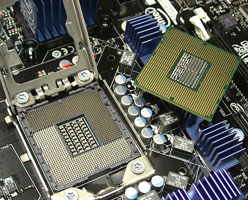 The new LGA1366 socket for the Core i7. With an integrated memory controller and with one more channel than normal, that's the main reason for the vast spike in pin count from the trusty old LGA775, other than more voltage control lines and the sort.