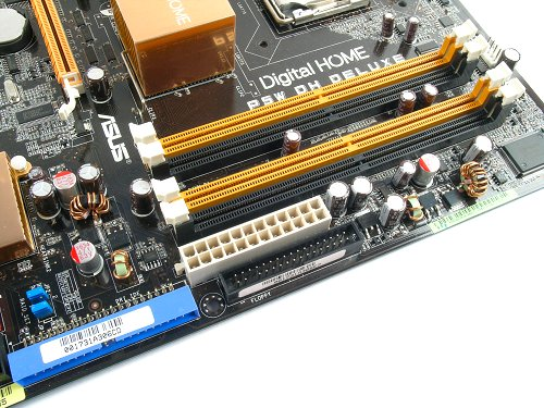 Good DIMM spacing with enough clearance to operate even with a full length graphics card. 24-pin ATX, primary IDE and floppy connectors are also located here.