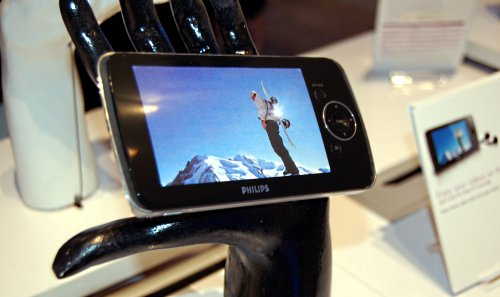 Philips new flash video GoGear players now comes anywhere from 1.5-inches to a huge 4-inch display offering up to 5 hours of video and 25 hours of audio. Models with a 2.5-inch and larger display can playback video up to 30fps. Depending on model, features include TV output, direct recording of TV programs, Bluetooth connectivity and of course Rhapsody connection. No WiFi support at the moment however.