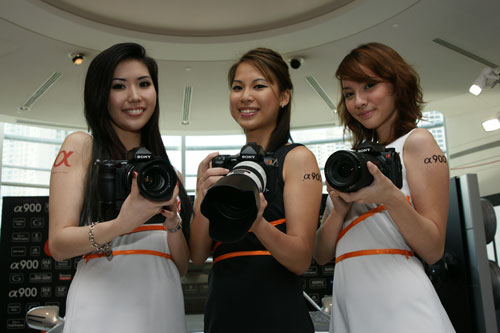 Three lovely models show the A900s off to the media.