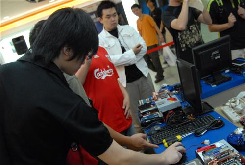 The contestants looking at the hardware for their competition.