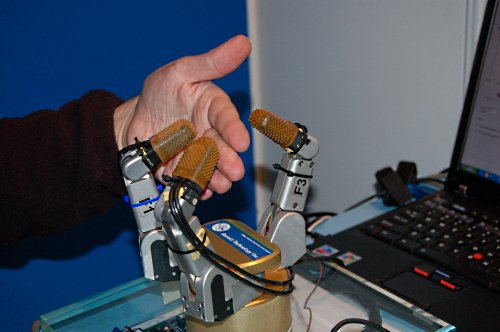 This is actually part of Intel's sensory research for device context awareness and ESP (Everyday Sensing and Perception). The robot hand here can sense objects in its grasp and react accordingly.
