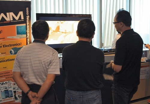 Hooked on High-Def goodness were these visitors to HWM's HD Booth.