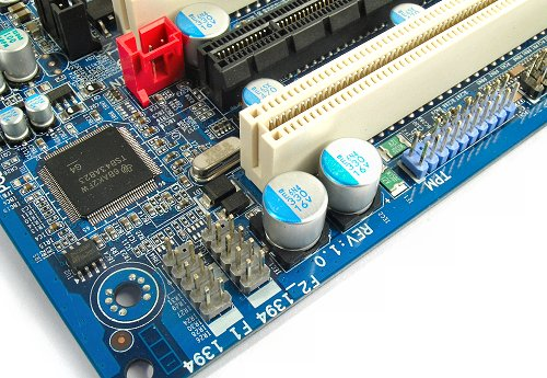 At the bottom rear corner of the board you can find the additional FireWire headers. Notice the TPM connector as well.