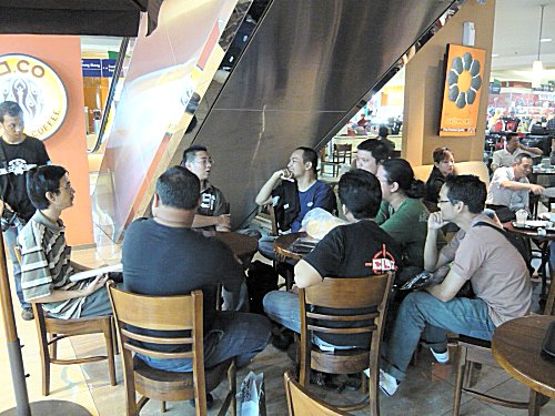 Having arrived early to check out the venue, our contestants headed over to a donut cafe to discuss their strategies.