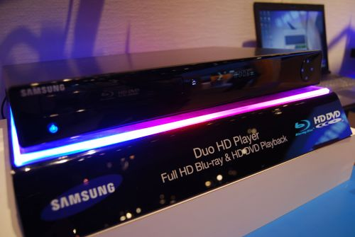 Samsung showcased the next-generation BD-UP5500 set-top next-gen disc player that allows users to play both Blu-ray and HD DVD discs in a slim and sleek design. Succeeding the UP5000, the UP5500 Duo HD player supports both BD-Java and HD DVD interactivity. Its Ethernet connection also allows viewers to experience a broad array of immersive viewing options with numerous movies as well as download new firmware for the player. Supporting 7.1-ch PCM, DTS-HD High Resolution and Master audio, and Dolby TrueHD Bitstream output via HDMI 1.3, the UP5500 is expecting a US release in the second half of 2008. It is however unfortunate that unlike the UP5000, this model doesn't come with the HQV processor.
