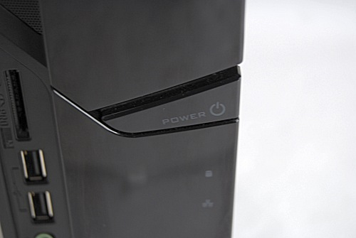 The only glossy surface that you'll ever touch when handling the X3600 would be this power button.