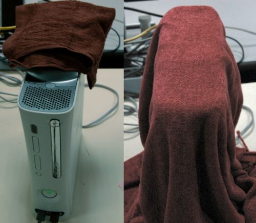 This picture is for illustration purposes only. On the right shows our Xbox covered in what appears to be a blanket as our towel (on the left) was too small.