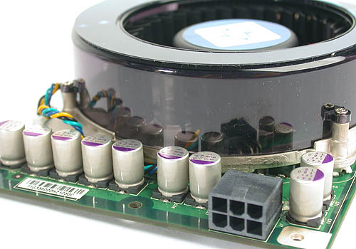 The only real estate on the PCB not taken by the two-slot cooler is covered by solid capacitors along with the requisite power connector.