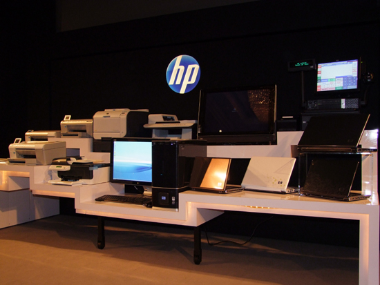 An array of printers and computing products featured at the event. In their midst is the HDX 900 Desktop PC (shown in the middle), a rig meticulously designed for multimedia and gaming functions. Just above the HDX sits the much anticipated TouchSmart IQ800 PC.