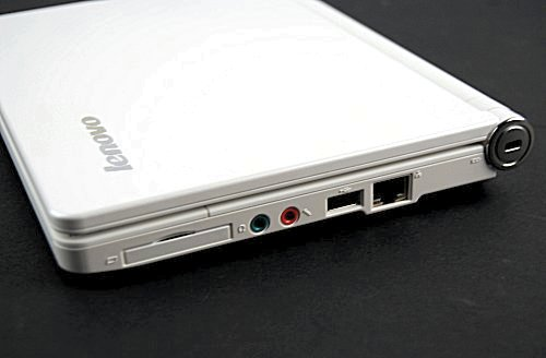 The right side of the unit features an ExpressCard/34 slot, the headphone jacks, a USB 2.0 port and a RJ-45 LAN port. Located on the hinge is a Kensington Lock slot.