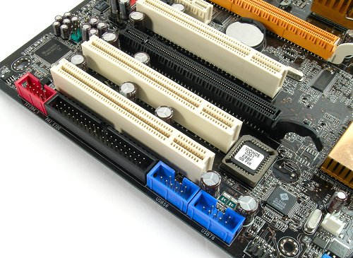 Row of extra headers (FireWire, IDE, USB) 'hidden' away towards the back of the board. Regular users might not require these functions, but if you do, they might be hard to reach.