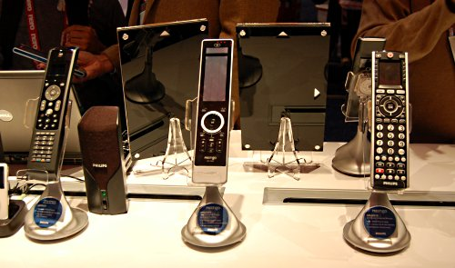 Range of Philips remote remote controls on display. The most interesting of the three is the SMJ3151 to the left. With a docking station, this product will allow you to control your iPod. Basically, instead of the iPod docking entertainment systems above, which will usually come with its own remote control, the SMJ3151 only provides the remote control to use with the iPod, you will still have to dock the docked iPod into a proper speaker system.