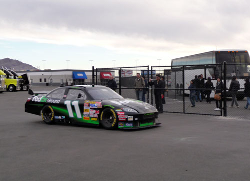 A NASCAR racecar pulls out of the pits at the Las Vegas Motor Speedway.