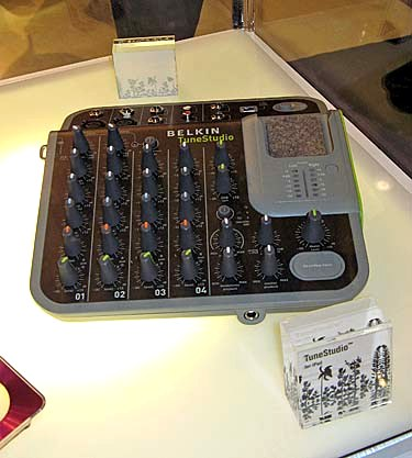 The Belkin TuneStudio is a four-channel mixer designed for the 5th-gen iPod (it docks to that gray compartment on the right). With it, you can record digital audio to the player at 16-bit, 44KHz quality. Four sources are permitted (with controls for each) and there�s a three-band equalizer. You can transfer your created music easily to a computer via USB. This is one compact (and pretty hardcore) portable studio.